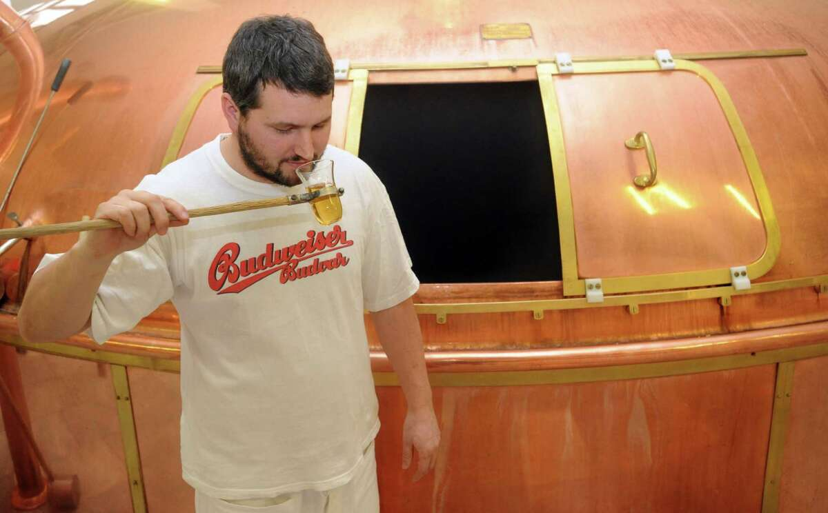(Bud Weisser not pictured) PHOTO: Technician samples Czech Budweiser beer straight from the vat at the Budejovicky Budvar brewery on January 22, 2010 in Ceske Budejovice, southern Bohemia.