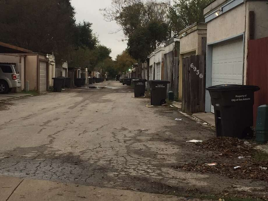 In the first time in a long time, this Camelot II alley is free of trash. A pilot trash pickup program promises that this will be an everyday occurrence. Photo: /