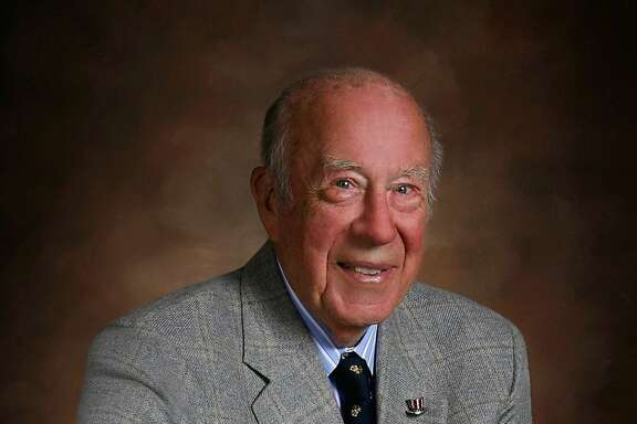 Former Secretary of State George Shultz poses in his Cabinet chair. By Michael Mustacchi. 2011.