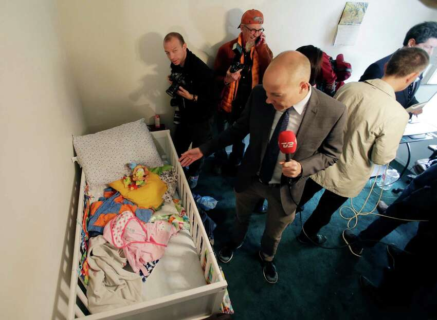 Members of the media crowd into a child's room in an apartment in Redlands, Calif., shared by San Bernardino shooting rampage suspects Syed Farook and his wife, Tashfeen Malik, Friday, Dec. 4, 2015, after the building landlord invited media into the townhouse rented by the California attackers.