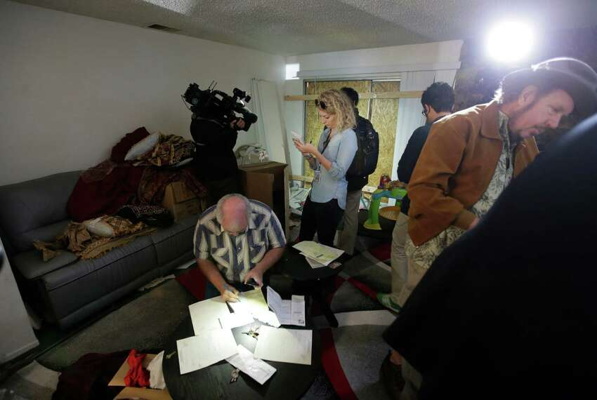 Members of the media crowd into the living room of an apartment in Redlands, Calif., shared by San Bernardino shooting rampage suspects Syed Farook and his wife, Tashfeen Malik, Friday, Dec. 4, 2015, after the building landlord invited media into the townhouse rented by the California attackers.