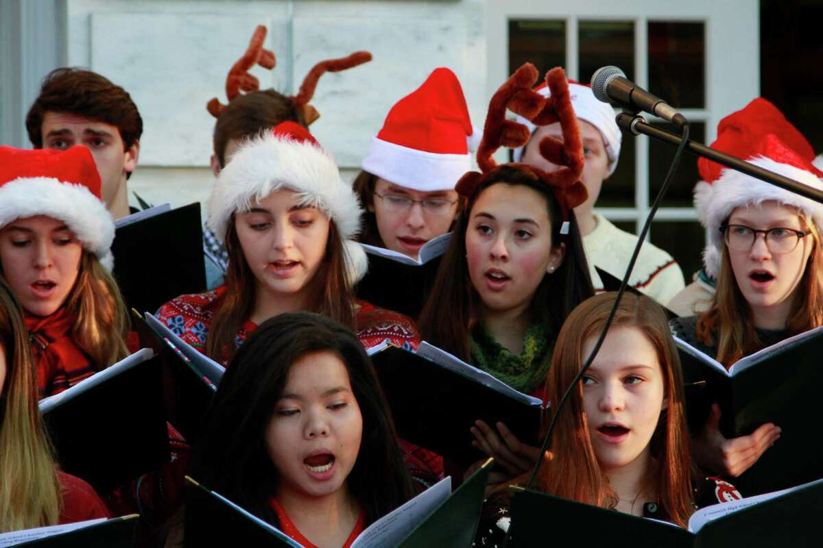 The Greenwich High School Chamber Chior entertains the crowd gathered for the annual Holiday Tree lighting in front of the Greenwich Town Hall in Greenwich, Conn. on Dec. 4, 2015.