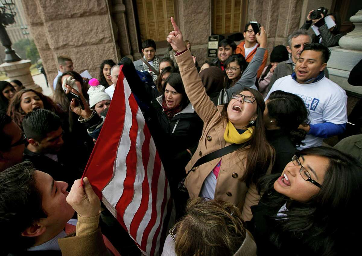 Maria Yolisma Garcia, 20, of Dallas, center, rallies in support of the HB1403, the Texas DREAM Act, at a demonstration at the Capitol in Austin, Texas, on Wednesday Jan. 14, 2015. More than 50 people, a coalition of businesses, affected students, supporters, and lawmakers, rallied to preserve the 2001 in-state tuition law. (AP Photo/Austin American-Statesman, Jay Janner) AUSTIN CHRONICLE OUT, COMMUNITY IMPACT OUT, INTERNET AND TV MUST CREDIT PHOTOGRAPHER AND STATESMAN.COM, MAGS OUT