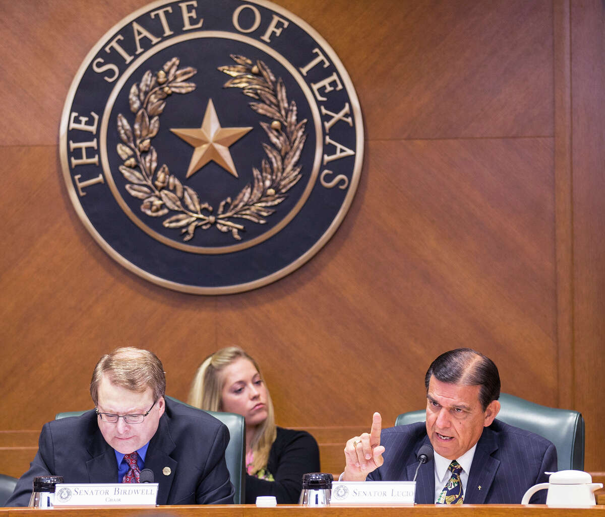 """Sen. Brian Birdwell, left, and Sen. Eddie Lucio look on during hearing on a bill that seeks to outlaw """"sanctuary cities"""" by prohibiting Texas governmental entities from passing laws to restrict police from asking about immigration status at the Texas State Capitol on Monday, March 16, 2015. (AP Photo/Austin American-Statesman, Ricardo B. Brazziell) AUSTIN CHRONICLE OUT, COMMUNITY IMPACT OUT, INTERNET AND TV MUST CREDIT PHOTOGRAPHER AND STATESMAN.COM, MAGS OUT"""
