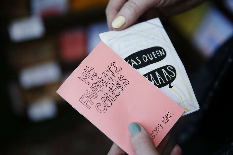 Courtney Riddle holds two of her zines which are for sale at The Grand Newsstand. Photo: Lea Suzuki, The Chronicle