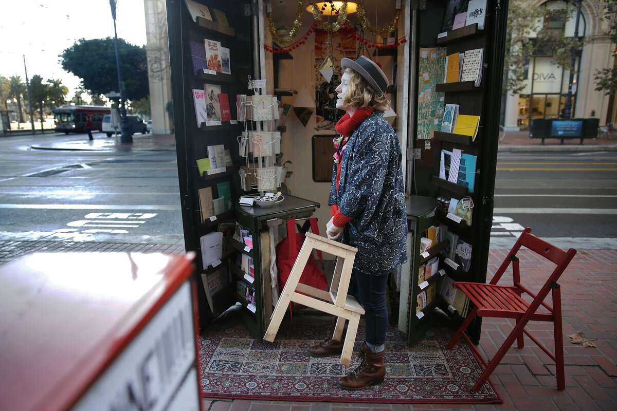 Courtney Riddle, owner of the Grand Newsstand, sets up chairs as she opens The Grand Newsstand.