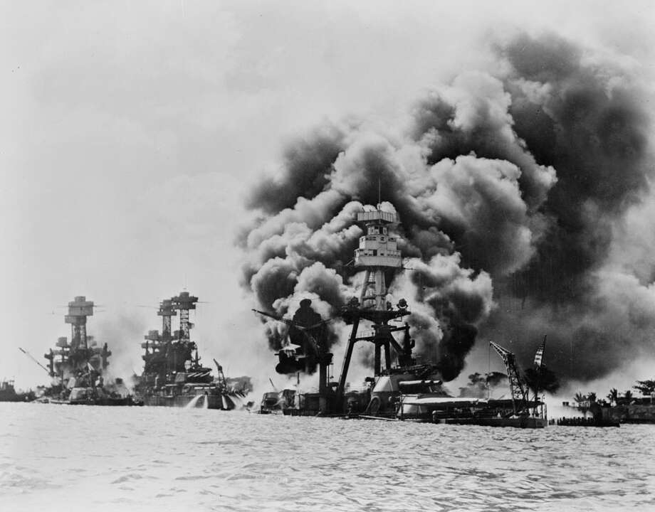 Then: Three stricken US battleships. Left to right, West Virginia, Tennessee and Arizona after the Japanese attack on Pearl Harbor in World War II, 1941. Photo: Universal History Archive, Getty Images / Universal Images Group Editorial