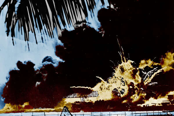 Pearl Harbour naval base and USS Shaw ablaze after the Japanese attack.