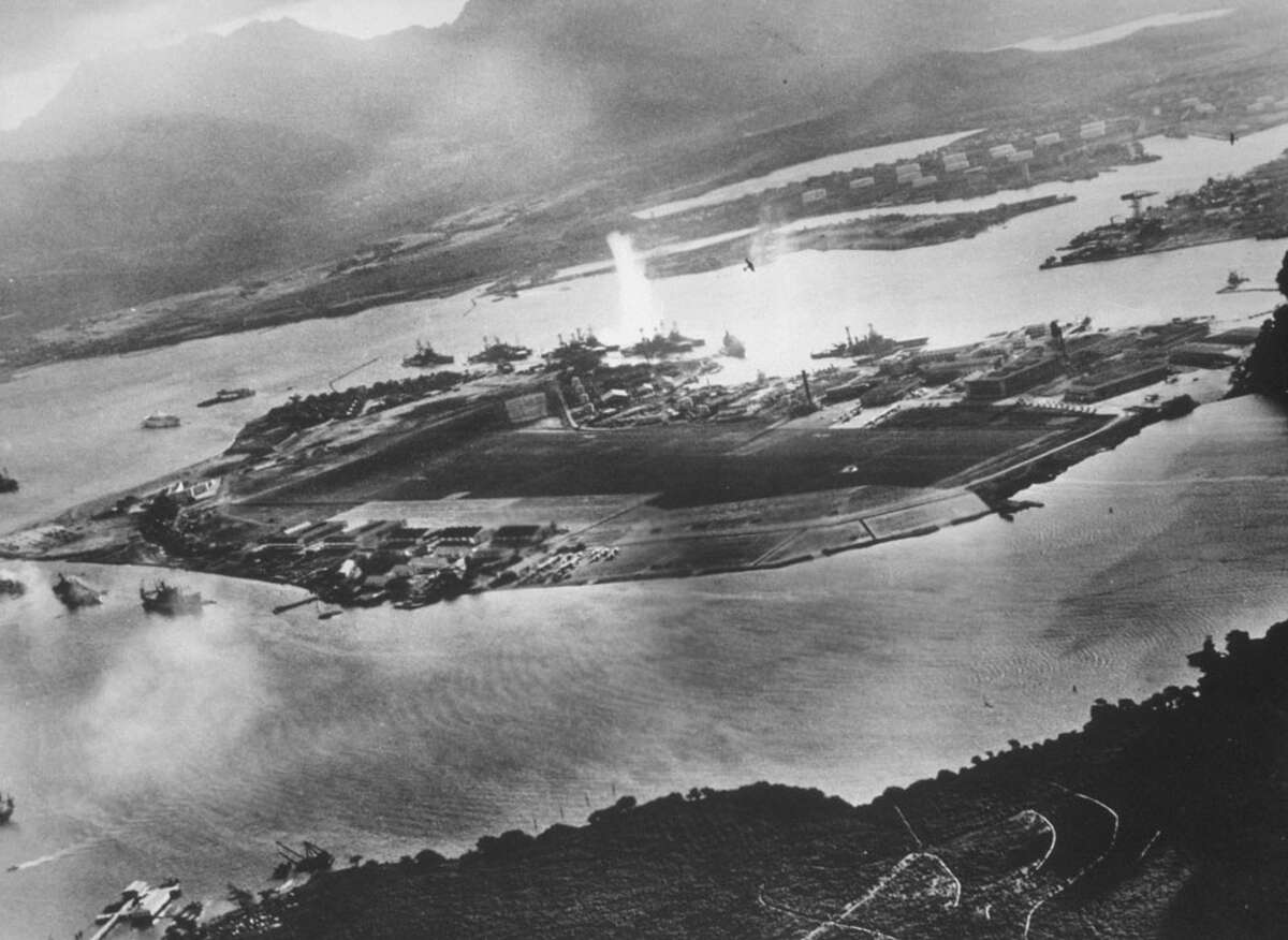 Then : Ford Island is seen in this aerial view during the Japanese attack on Pearl harbor December 7, 1941 in Hawaii. The photo was taken from a Japanese plane. December 7, 2001 marks the 60th anniversary of the Japanese attack on Pearl Harbor.