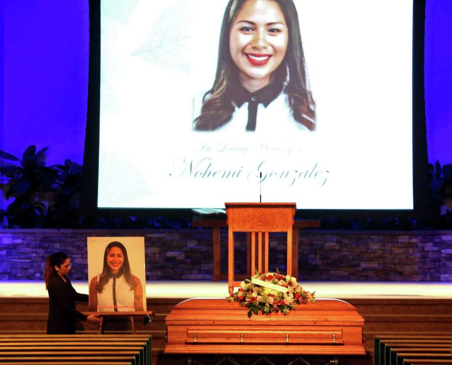 As European nations carried out retaliatory raids against ISIS in Syria, in California a woman sets up a picture of Paris attack victim Nohemi Gonzalez for her funeral at the Calvary Chapel in Downey, Calif., on Friday. Gonzalez was the 23-year-old Cal State Long Beach studentwho was killed while dining with friends at a bistro in Paris on Nov. 13. Photo: Genaro Molina /Los Angeles Times / Los Angeles Times