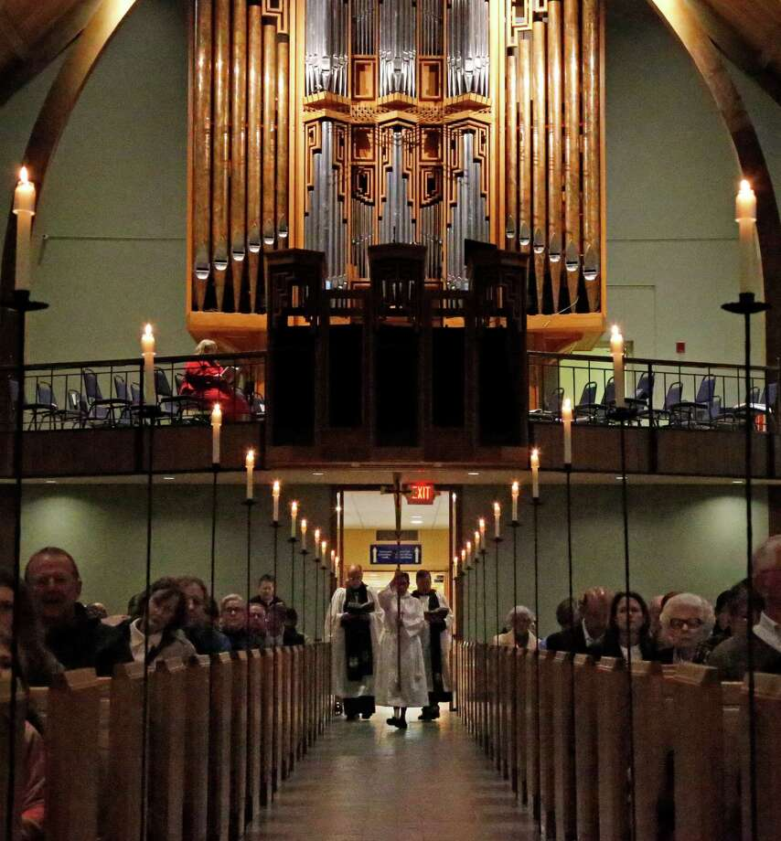 A Silent Procession started the Advent Lessons and Carols Service at St. Luke's Episcopal Church on Nov. 29, days after the K-8 parish school informed parents it would accept and embrace a transitioning transgender student. Photo: Ron Cortes /