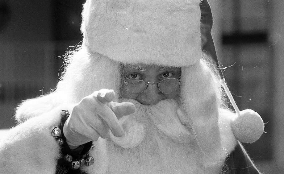 Santa points out who's naughty and nice at the parade on Nov. 22, 1981. Photo: Steve Ringman, The Chronicle