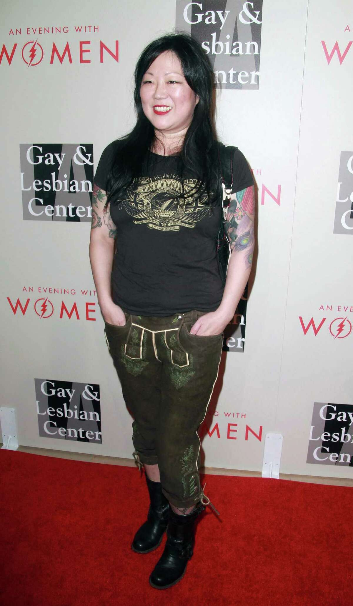 """Margaret Cho arrives at The L.A. Gay and Lesbian Center's Annual """"An Evening With Women"""" at The Beverly Hilton on Saturday, May 10, 2014, in Beverly Hills, Calif. (Photo by Theresa Bouche/Invision/AP Images) ORG XMIT: CATB!)$"""