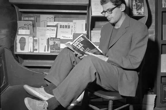 Allen Ginsberg thumbs through a Jack Kerouac work at a San Francisco bookstore in June 1959.