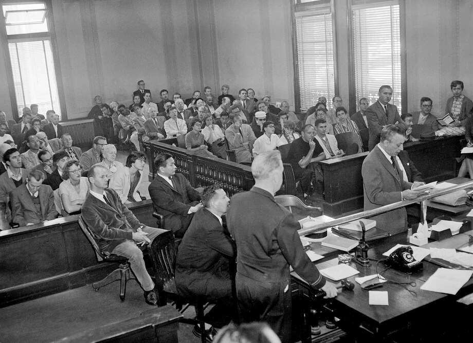"The ""Howl"" trial opens with defendants Lawrence Ferlinghetti and Shigeoyoshi Murao (inside railing at left), plus defense attorneys Lawrence Speiser (left of table) and J.W. Ehrlich (in front of the bar at right). Photo: The Chronicle / ONLINE_YES"