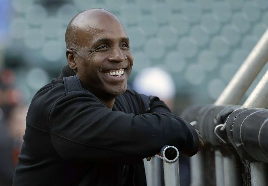 FILE - In this Aug. 25, 2015, file photo, former baseball player Barry Bonds smiles before a baseball game between the San Francisco Giants and the Chicago Cubs in San Francisco. Steroids-tainted home run king Barry Bonds is returning to baseball full time as hitting coach for the Miami Marlins. (AP Photo/Jeff Chiu, File) Photo: Jeff Chiu, Associated Press