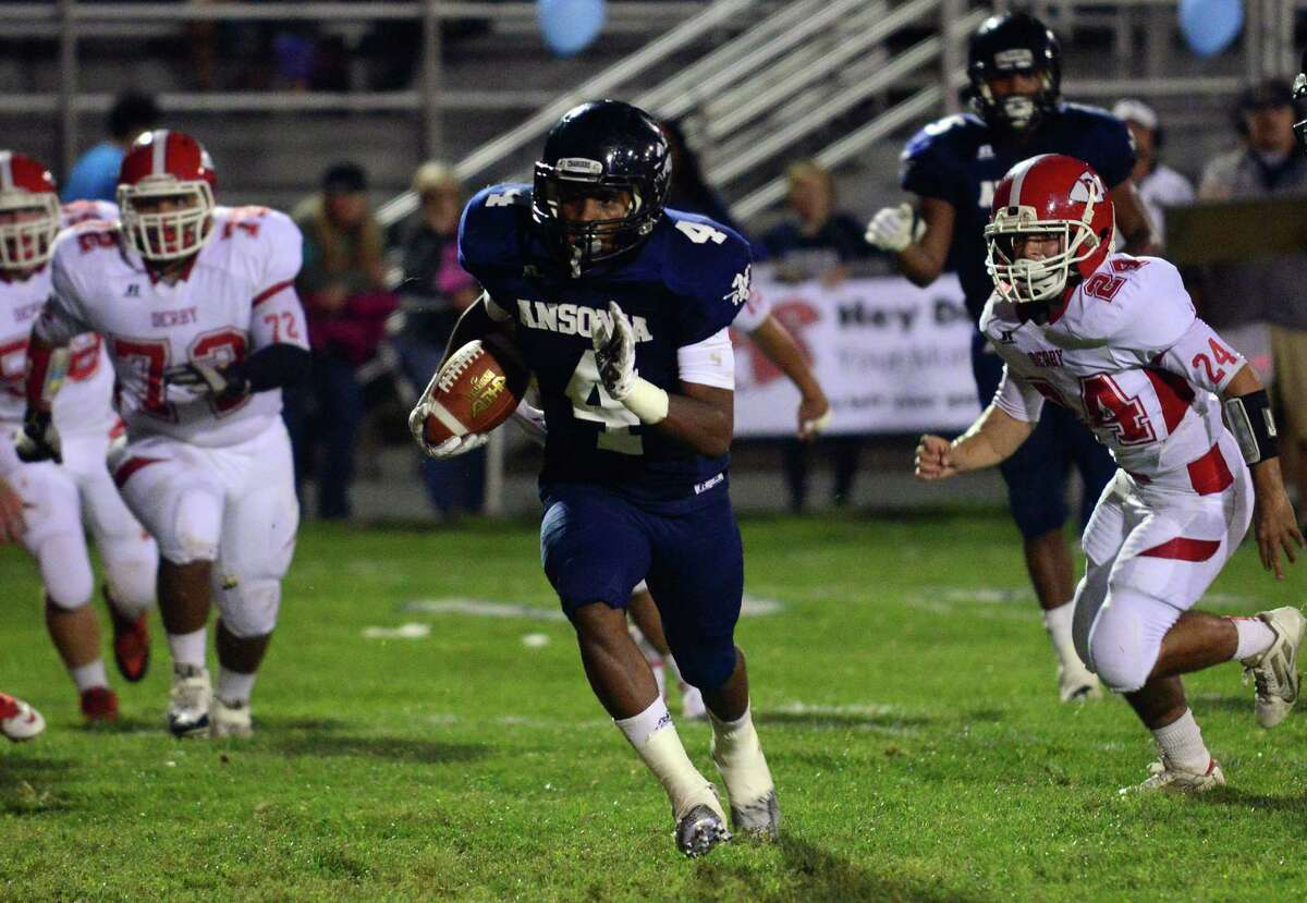 Ansonia's Tajik Bagley takes off for the endzone to score, during high school football action against Derby in Ansonia, Conn. on Friday Sept. 25, 2015.