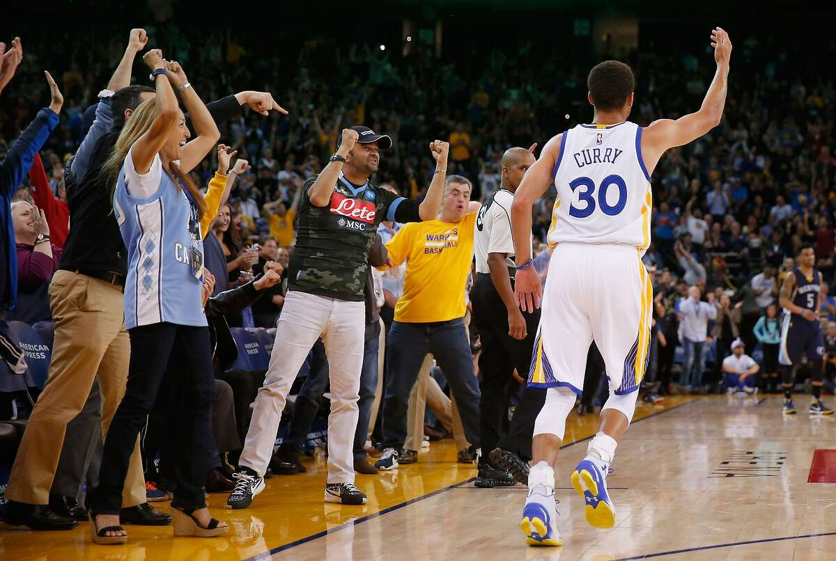 OAKLAND, CA - NOVEMBER 02: The crowd reacts with Stephen Curry #30 of the Golden State Warriors after Curry made a basket during the third period of their game against the Memphis Grizzlies at ORACLE Arena on November 2, 2015 in Oakland, California. NOTE TO USER: User expressly acknowledges and agrees that, by downloading and or using this photograph, User is consenting to the terms and conditions of the Getty Images License Agreement. (Photo by Ezra Shaw/Getty Images)
