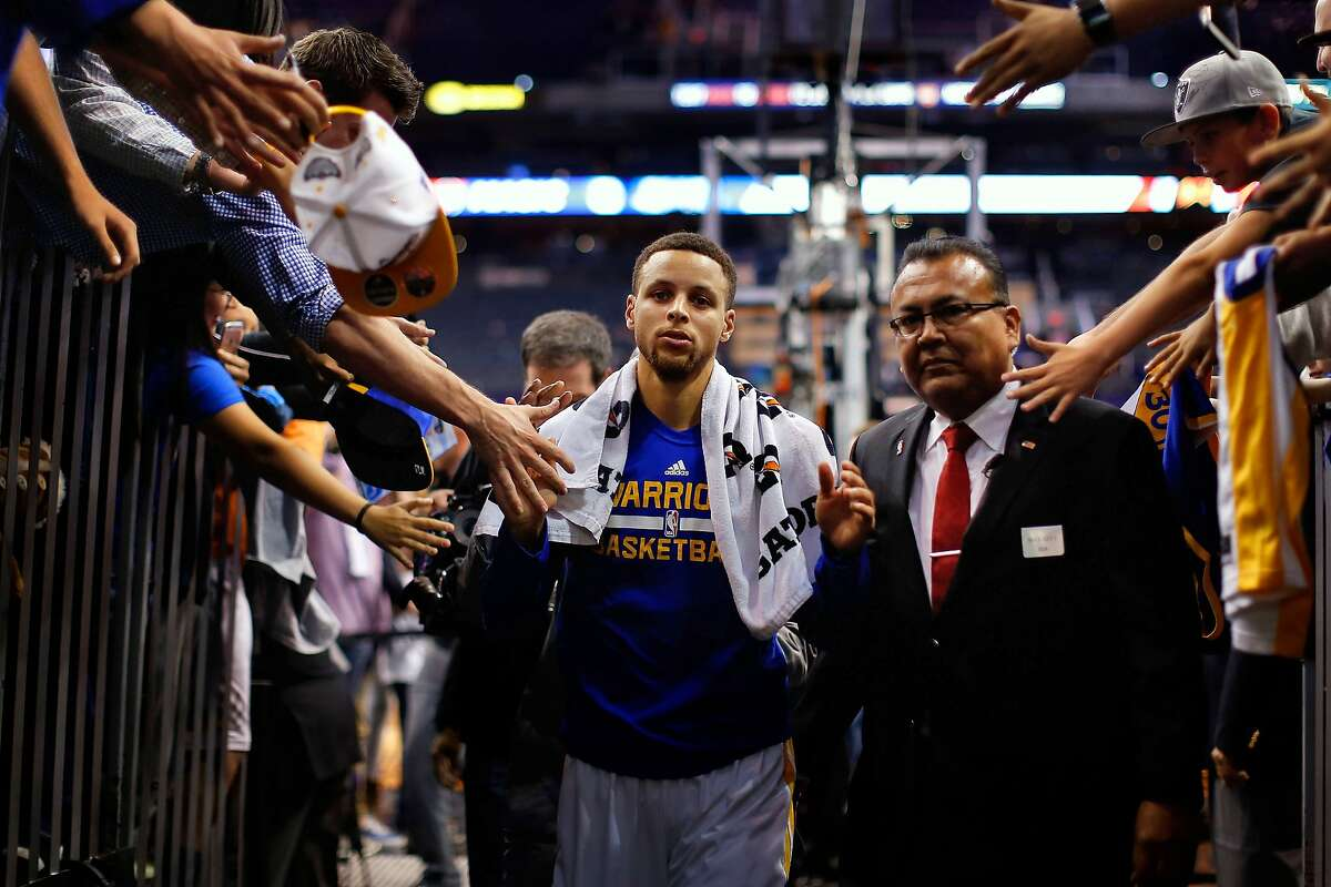 PHOENIX, AZ - NOVEMBER 27: Stephen Curry #30 of the Golden State Warriors high fives fans as he walks off the court following the NBA game against the Phoenix Suns at Talking Stick Resort Arena on November 27, 2015 in Phoenix, Arizona. The Warriors defeated the Suns 135-116. NOTE TO USER: User expressly acknowledges and agrees that, by downloading and or using this photograph, User is consenting to the terms and conditions of the Getty Images License Agreement. (Photo by Christian Petersen/Getty Images)