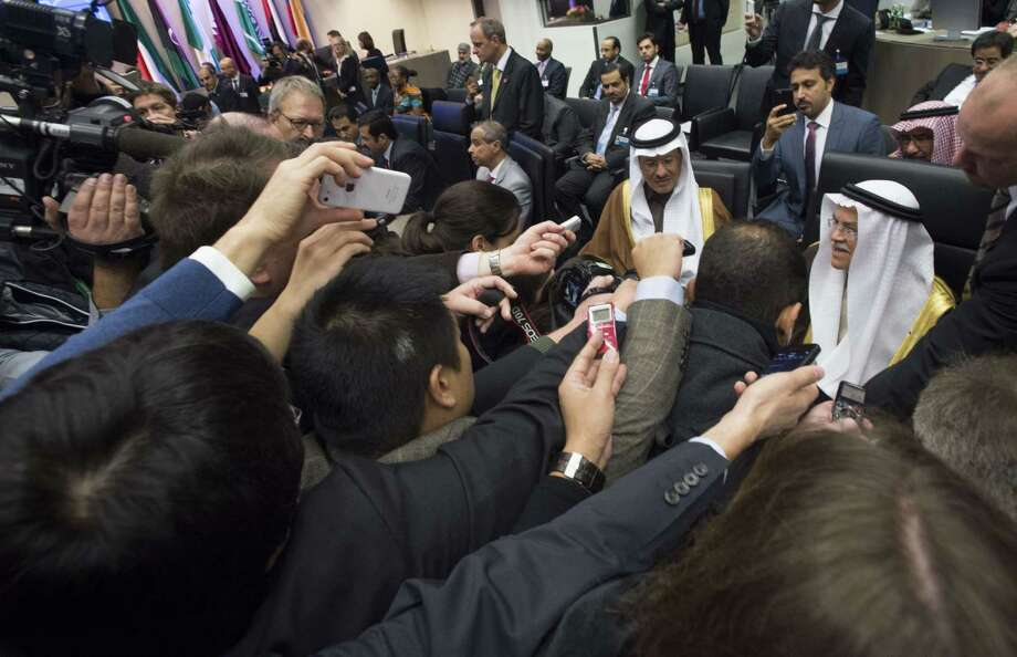 Saudi Arabia's minister of Oil and Mineral Resources Ali al-Naimi (bottom right) is surrounded by journalists at the 168th Ordinary meeting of the Conference of the Organization of the Petroleum Exporting Countries, OPEC,  in December. Photo: Joe Klamar /AFP / Getty Images / AFP
