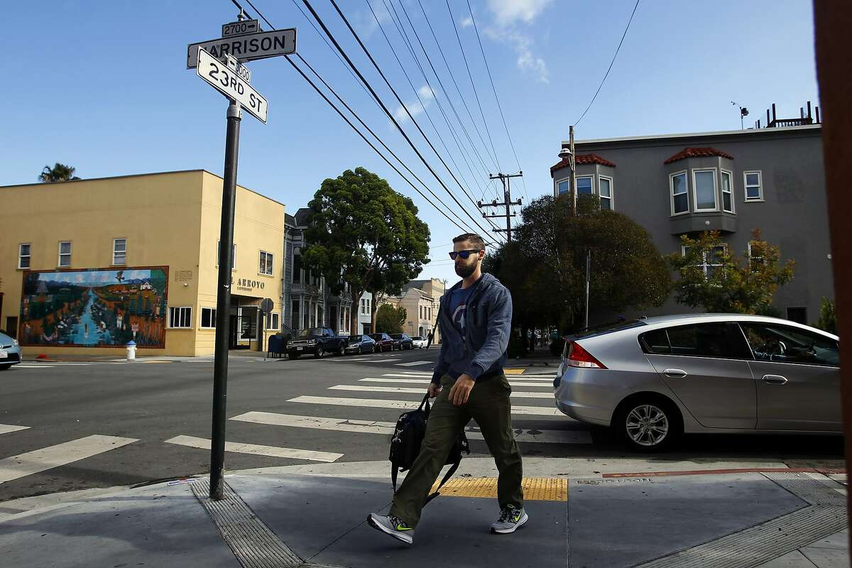 Nick Soignier, a sales engineer, walks from a cab ride to his place on 23rd and Harrison Streets.