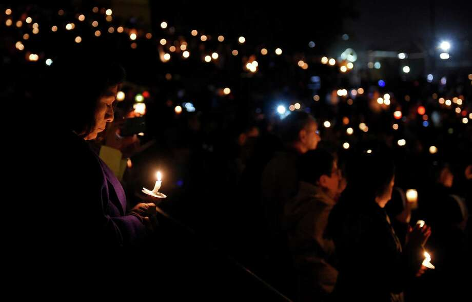 A candlelight vigil was held for the San Bernardino shooting victims on Thursday, Dec. 3, 2015, at San Manuel Stadium in San Bernardino, Calif. (AP Photo/Mark J. Terrill) Photo: Mark J. Terrill, STF / AP