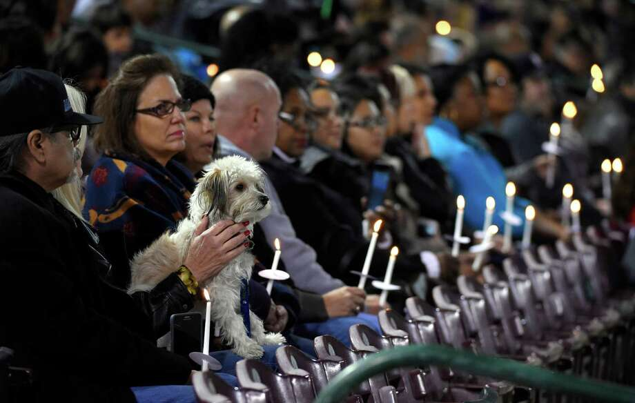 People listen during a candlelight vigil at San Manuel Stadium, Thursday, Dec. 3, 2015, in San Bernardino, Calif., for multiple victims of a shooting that took place at a holiday banquet on Wednesday. (AP Photo/Mark J. Terrill) Photo: Mark J. Terrill, STF / AP