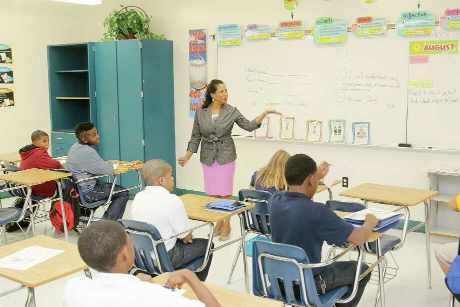 LaMarque ISD Superintendent Terri Watkins visiting students at LaMarque Elementary school first day of class. Phtoo by Pin Lim. Photo: Pin Lim, Freelance / Copyright Forest Photography, 2015.