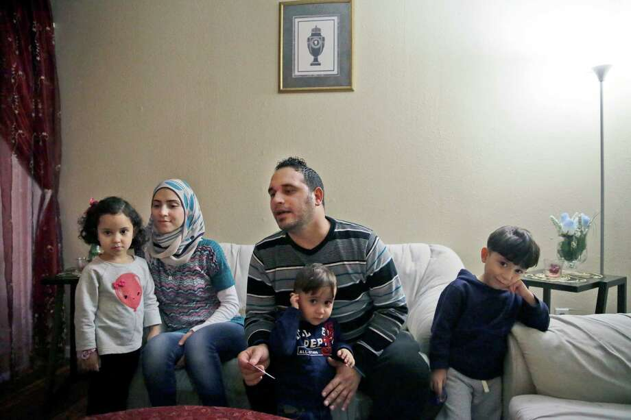 Bashar al Jaddou (center), shown with his family in Dallas, said he decided to leave Syria in 2012 after their home was bombed. Photo: LM Otero / Associated Press / AP
