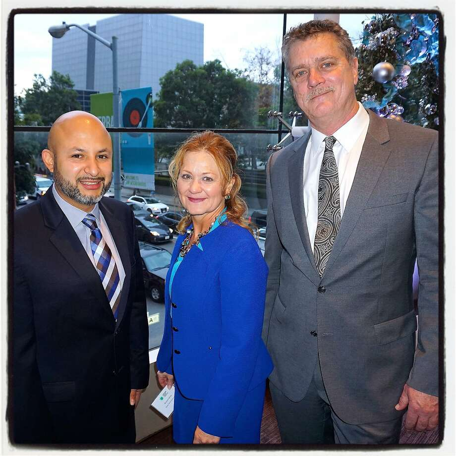 TP staffer Nick Arevalo (left) with his fellow TP Award honorees Nurse-Family Partnership President Roxanne White and Stride Center Executive Director Barrie Hathaway at the St. Regis Hotel. Dec 2015. Photo: Catherine Bigelow, Special To The Chronicle