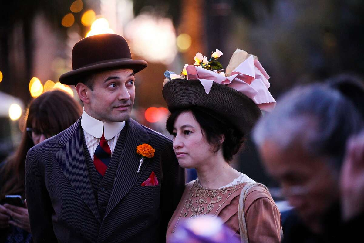 John Vinopal (center) and Aimee Baldwin donned costumes for the closing ceremony of the 1915 lights at the Ferry building in San Francisco, California on Friday, December 4, 2015.