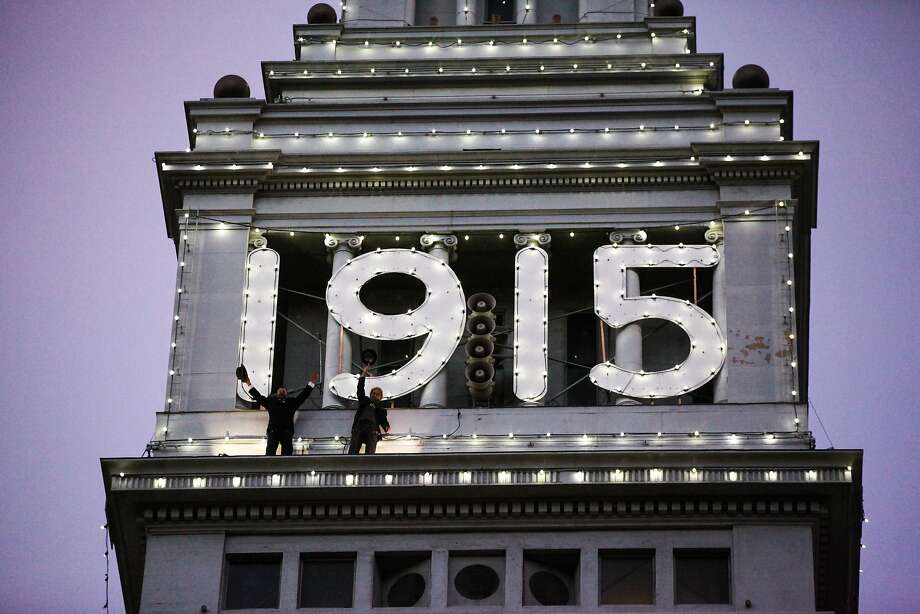 Jim Phelan (left) and his nephew Tyrone Mancuso stand on the ledge of the Ferry building as part of the final lighting ceremony of the 1915 lights at the Ferry building in San Francisco, California on Friday, December 4, 2015. Photo: Gabrielle Lurie, Special To The Chronicle