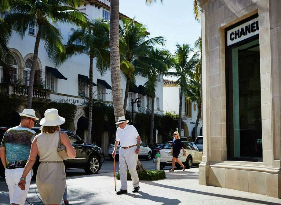 People pass the Chanel store on Worth Avenue in West Palm Beach, Fla., which has long been a refuge for the retired rich, but is growing older still. New research shows that despite their high profile, the young rich of Silicon Valley and Wall Street are still the minority and the wealthy as a group actually are getting older. Photo: Ryan Stone /New York Times / NYTNS