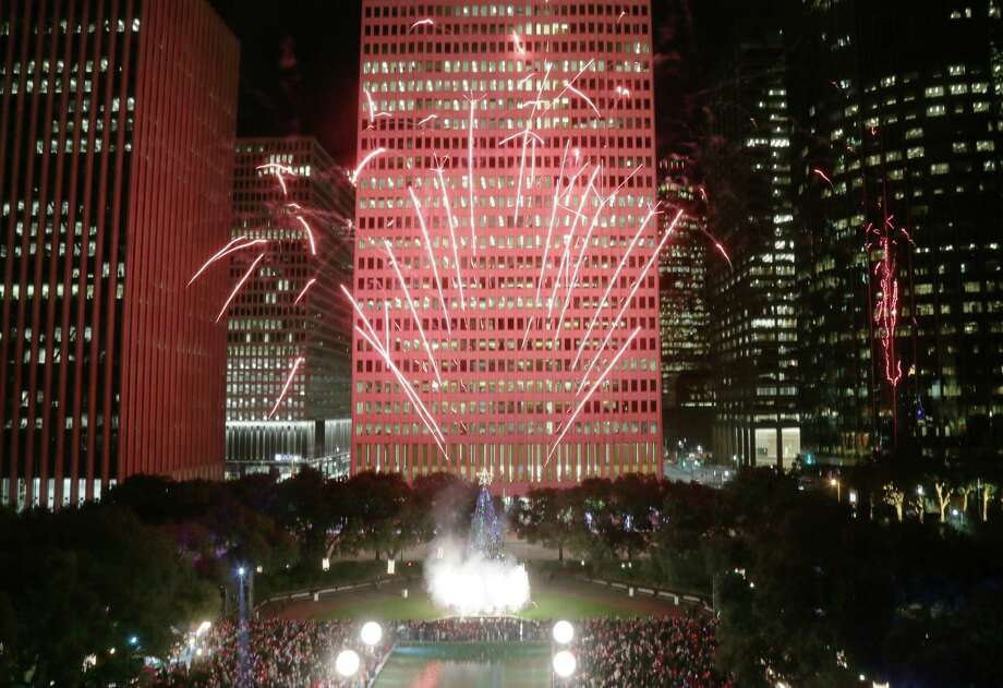 Fireworks steal the show at the 96th Annual Mayor's Holiday Celebration and Tree Lighting at Hermann Square Park on Dec. 4. Photo: Jon Shapley, Houston Chronicle / © 2015  Houston Chronicle