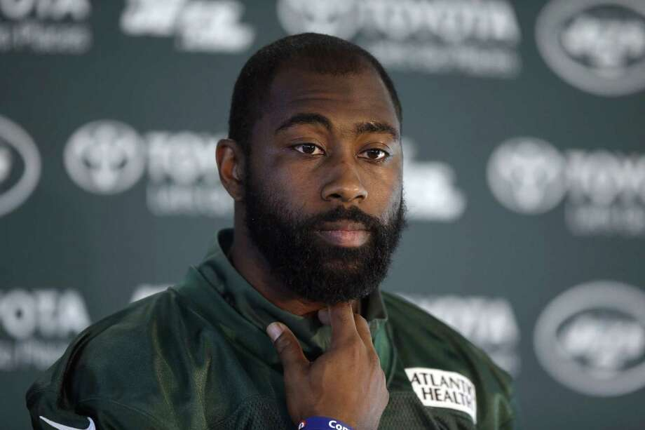FILE - In this Oct. 2, 2015, file photo, New York Jets cornerback Darrelle Revis gives a press conference after an NFL training session at London Irish training ground in south west London. The Jets are taking on Odell Beckham Jr. without Darrelle Revis. Coach Todd Bowles announced Friday, Dec. 4, 2015, that the star cornerback is officially listed as out for the game Sunday because of a concussion. (AP Photo/Matt Dunham, File) Photo: Matt Dunham, STF / AP