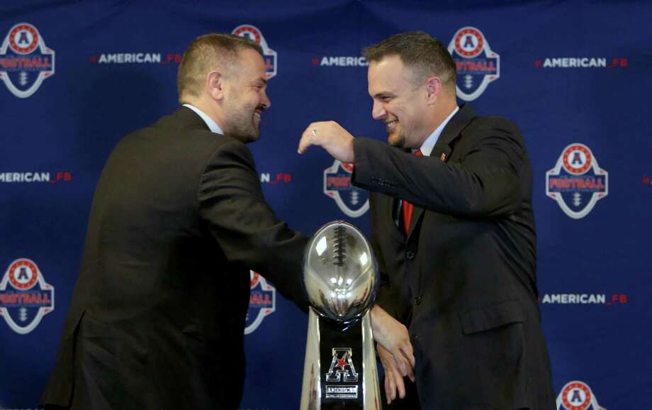Temple Owls coach Matt Rhule, left, and Houston Cougars coach Tom Herman are happy to be in the American Athletic Conference title game. Photo: Gary Coronado, Staff / © 2015 Houston Chronicle