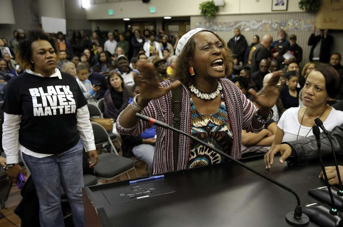 Neighborhood resident Salahaquekyah Chandler speaks her mind as the San Francisco Police department hosts a town hall meeting, on Fri. December 4, 2015 to discuss the officer-involved shooting of 26-year-old Mario Woods in the Bayview neighborhood that sparked outrage nationwide after a video taken of the shooting was circulated on social media, in San Francisco, Calif.
