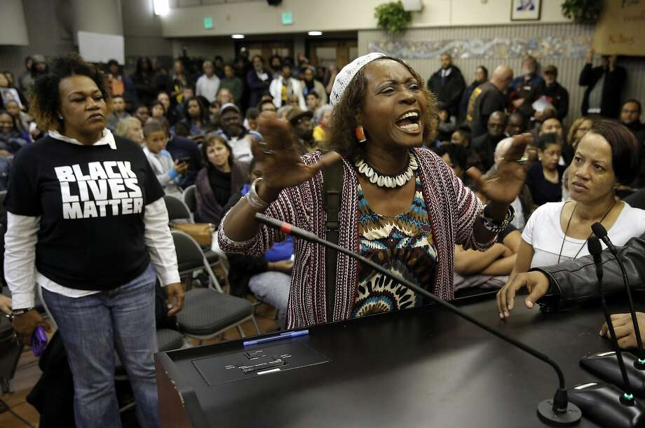 Neighborhood resident Salahaquekyah Chandler  speaks her mind as the San Francisco Police department hosts a town hall meeting, on Fri. December 4, 2015 to discuss the officer-involved shooting of 26-year-old Mario Woods in the Bayview neighborhood that sparked outrage nationwide after a video taken of the shooting was circulated on social media, in San Francisco, Calif. Photo: Michael Macor, The Chronicle