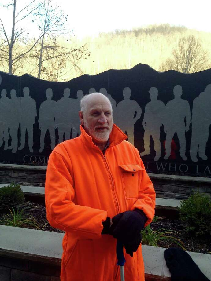 Retired carpenter Glenn Thompson stands in front of the Upper Big Branch Miners Memorial on Thursday, Dec. 3, 2015, in Whitesville, W.Va.  The memorial honors 29 miners killed in an explosion at the nearby Upper Big Branch mine in April 2010. Don Blankenship, former CEO of Massey Energy, was convicted of conspiring to willfully violate mine safety and health standards on Thursday in federal court in Charleston. (AP Photo/John Raby) Photo: John Raby, STF / ap