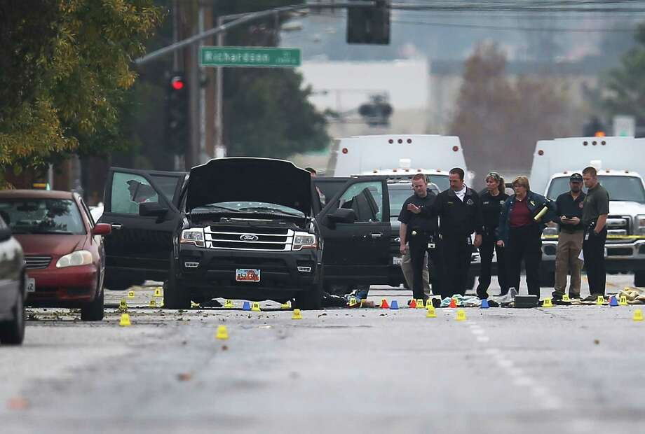 Two days after the couple suspected in the mass shooting in San Bernardino, Calif., were killed in a shootout with authorities, the SUV they were driving remains on the street where the shootout occurred. Photo: Joe Raedle, Staff / 2015 Getty Images