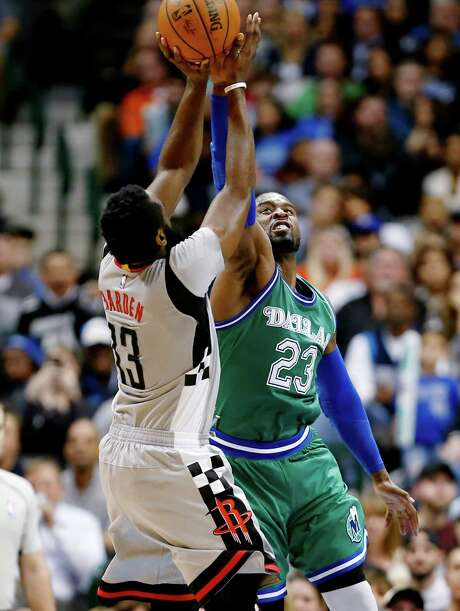 Rockets guard James Harden, who finished with 25 points, nine assists and eight rebounds, puts a shot up over Mavericks guard Wesley Matthews on Friday. Photo: Brandon Wade, FRE / FR168019 AP