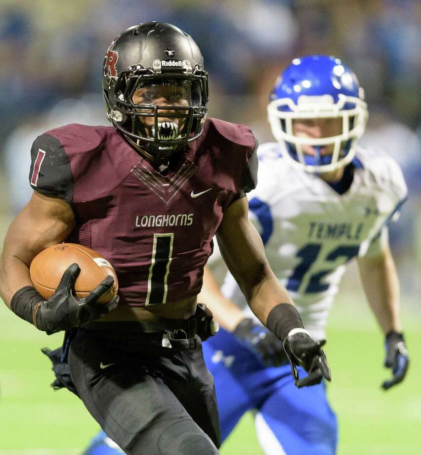 Darius Anderson (1) of the George Ranch Longhorns runs for a short gain in the first half against the Temple Wildcats in high school football's Class 5A Division I state quarterfinals on Friday, December 4, 2015 at Berry Center Stadium. Photo: Wilf Thorne / © 2015 Houston Chronicle