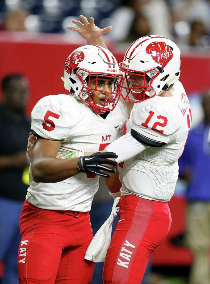 Katy's Kyle Porter (5) celebrates his second of four touchdowns with QB Garrett Doiron (12) during the first half of a high school football game at NRG Stadium on Friday, Dec. 4, 2015, in Houston   ( Karen Warren / Houston Chronicle ) Photo: Karen Warren, Staff / © 2015  Houston Chronicle