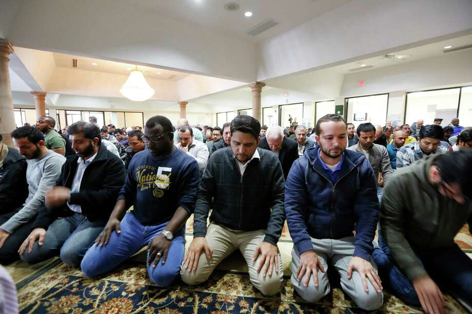 Worshipers offer their prayers for the victims and families of the San Bernardino shooting, Friday, Dec. 4, 2015, at the Islamic Society of Greater Houston. Photo: Steve Gonzales, Houston Chronicle / © 2015 Houston Chronicle