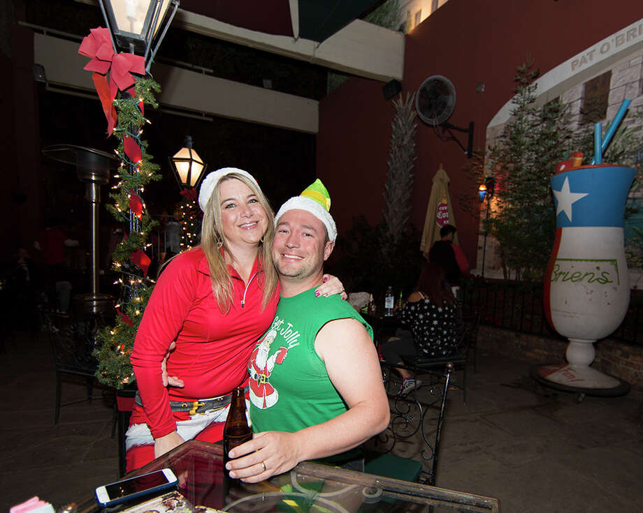San Antonians put on their best holiday garb and took a running tour of downtown San Antonio bars  Dec. 4, 2015 in the first official First Friday Pub Run. Photo: B. Kay Richter