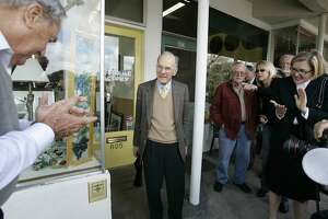 FILE - In this March 20, 2007 file photo Chuck Williams, center, founder of Williams-Sonoma Inc., stands outside his very first storefront as a plaque, lower left, is unveiled to mark his company's 50th anniversary in Sonoma, Calif.  High-end cookware retailer Williams-Sonoma could be blocked from returning to its hometown, as the Sonoma City Council considers enacting a moratorium on chain stores. The company has been in discussions to buy the downtown building where it opened its first store in 1956. (AP Photo/Eric Risberg, File)