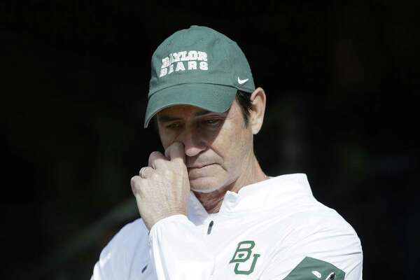 Baylor head coach Art Briles gets emotional in the tunnel after his senior players were introduced before an NCAA college football game against Texas Saturday, Dec. 5, 2015, in Waco, Texas. (AP Photo/LM Otero)