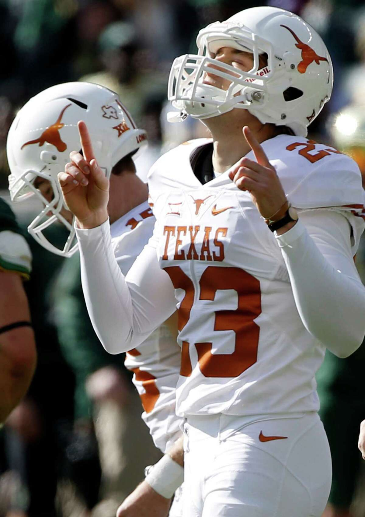 WACO, TX - DECEMBER 5: Nick Rose #23 of the Texas Longhorns points skyward after kicking a field goal against the Baylor Bears in the first half at McLane Stadium on December 5, 2015 in Waco, Texas.