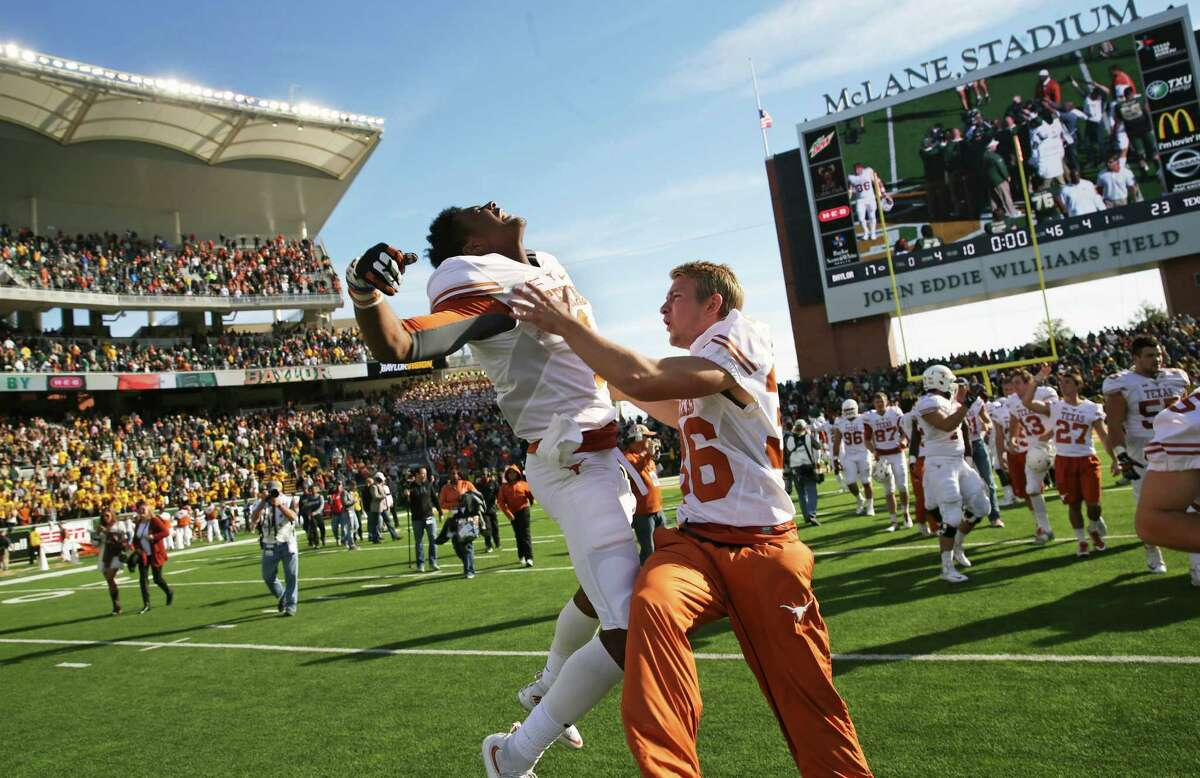 Longhorn players celebrate after upsetting the Bears 23-17 as Baylor hosts Texas at McClane Stadium in Waco on December 5, 2015.