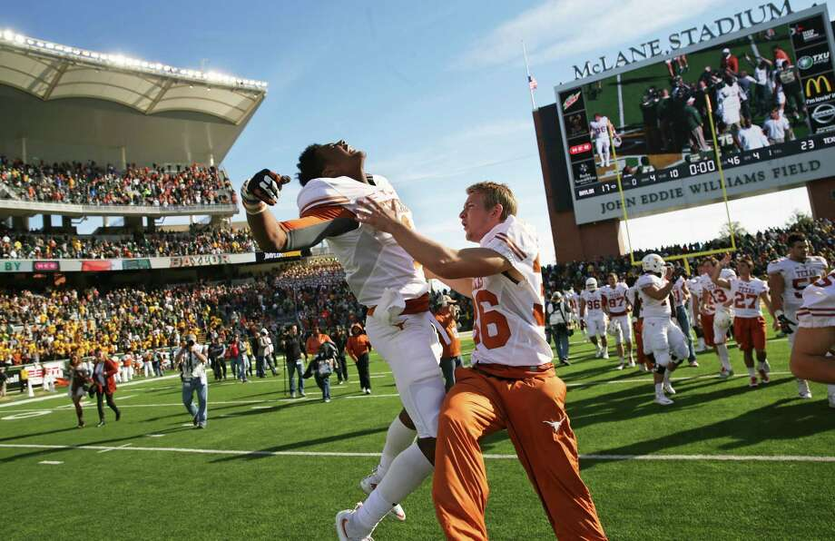 Longhorn players celebrate after upsetting the Bears 23-17 as  Baylor hosts Texas at McClane Stadium in Waco on December 5, 2015. Photo: TOM REEL, SAN ANTONIO EXPRESS-NEWS / 2015 SAN ANTONIO EXPRESS-NEWS